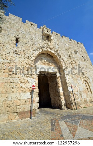 JERUSALEM - OCTOBER 5: Zion Gate facade on October 5, 2012 in Jerusalem. Zion Gate was built for Suleiman the Magnificent in 1540 and is one of eight gates in the walls of the Old City of Jerusalem.