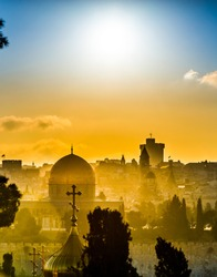 Jerusalem roofs: Dome of the Rock and the Russian church of Mary Magdalene, church steeples of the Old City, fortified wall of the Tower of David and high rise hotel of West Jerusalem in a sunset haze