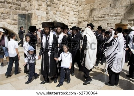 JERUSALEM -SEPT 27: Jews in prayer at the Western Wall during Jewish holiday of Sukkot September 27, 2010 in Jerusalem, Israel.