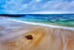 Jervis bay pristine white sands of Hyams and Chinamans beaches at sunset - scenic seascape of Pacific ocean in Australia.