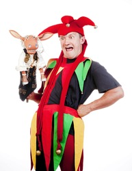 jester - entertaining figure in typical costume with puppet