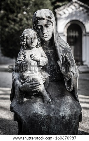 jesus christ and virgin mary statue in the cemetery