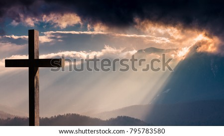 Jesus Christ cross. Easter, resurrection concept. Christian wooden cross on a background with dramatic lighting, colorful mountain sunset, dark clouds and sky, sunbeams  #795783580
