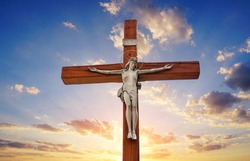 Jesus Christ crucified in the sunset, believing in God. Christian religion