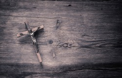 Jesus Christ crucified n wooden background.Easter concept.