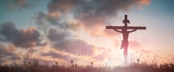 Jesus christ crucifix death on cross in calvary hills sunset lights good friday risen in easter sunday service concept for Christian praise for holy spirit God, Catholic church panoramic background.