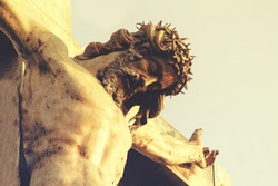 Jesus Christ in a crown of thorns, crucifixion. The concept of faith in God