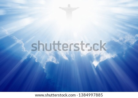 Jesus Christ in blue sky with clouds, bright light from heaven, resurrection, easter #1384997885