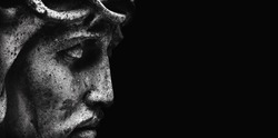Jesus Christ in profile. An ancient statue. Religion, faith, death, suffering, immortality, God concept.