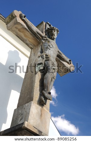 Jesus Christ on the cross - carved stone