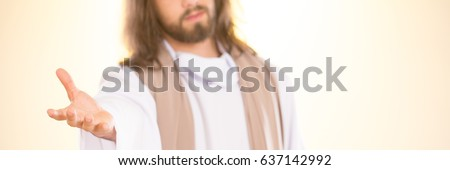 Jesus Christ reaching out his hand against bright background #637142992