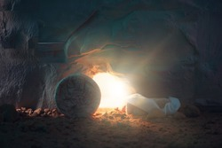 Jesus Christ resurrection. Christian Easter concept. Empty tomb of Jesus with light. Born to Die, Born to Rise.