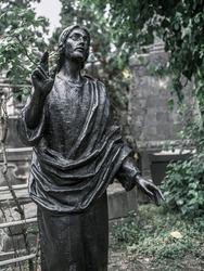 Jesus Christ sculpture on a grave. High quality photo