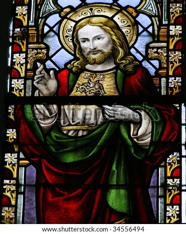 Jesus Christ. Stained glass window (made in the 1920s) in the church of Braine-le-Chateau near Brussels in Belgium
