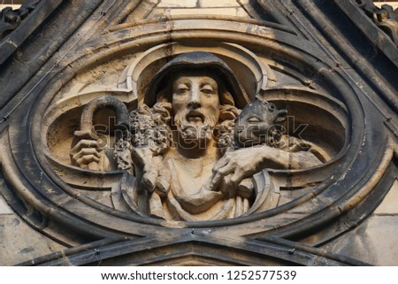 Jesus Christ Statue Relief In The Beautiful Historical Prague City At Sunny Day. Historic Highlights of Czech Republic. Grey Stone Background. #1252577539