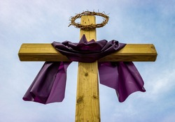 Jesus crown of thorns on top of wooden post outside Christian religious church during Lent before Easter holiday