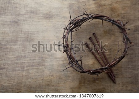 Photo of Jesus Crown Thorns and nails on Old and Grunge Wood Background. Vintage Retro Style. Free space for text
