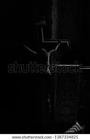 Jesus crucifixion in the dark corner of ancient Armenian monastery - Black and white image