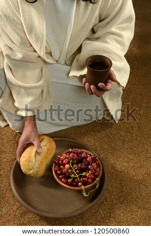 Jesus hands holding communion symbols: bread and wine