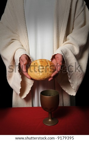 Jesus hands holding the bread at the Communion table