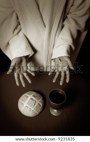 Jesus hands with scars offering the Communion elements of bread and wine