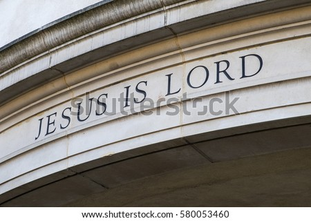 Jesus is Lord sign on the exterior of a church building. #580053460