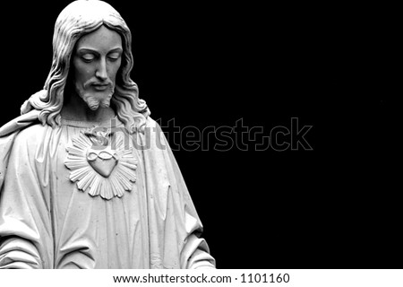Jesus looking down, isolated on a black background copy-space
