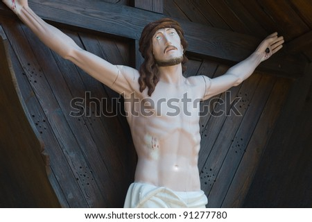 Jesus on a cross in a chapel in Italy - stock photo