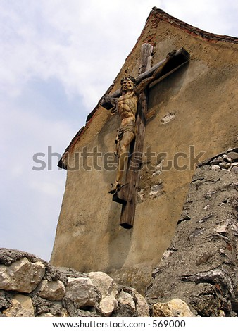 Jesus on the cross with a wall in the foreground
