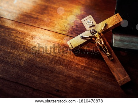 Jesus's crucifix over bible on wooden table background,Christian world mission concept,  copy space Stock photo ©
