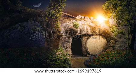 Jesus's empty tomb at sunrise. Concept of resurrection.
