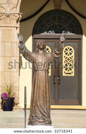 jesus statue in front of church doors