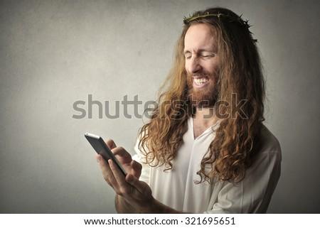 Jesus using a smartphone