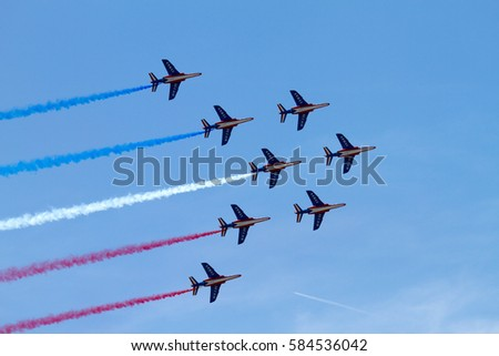 Jet aircrafts aerobatic group of French Air Force drawing french flag figure in the sky, during Le Bourget Paris air show