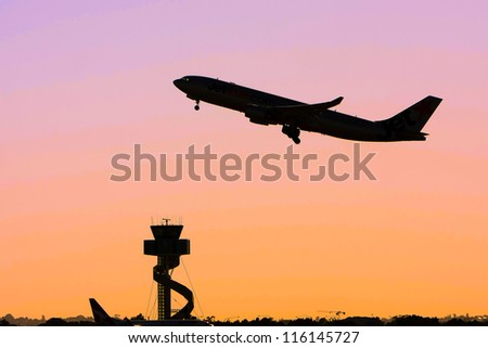 Jet airliner in flight at sunset
