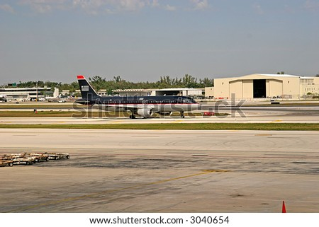 Jet airliner taxing on an airport runway