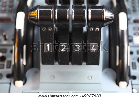 jet airplane four thrust levers in the cockpit