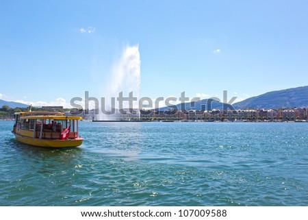 Jet d'Eau on Lake Geneva, Switzerland with ferry crossing the lake - stock photo