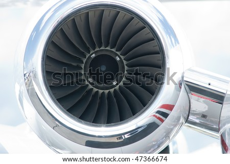 Jet engine of business jet airplane with chrome cowling