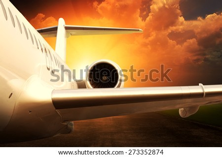 Jet engine on parked airplane over sunset background
