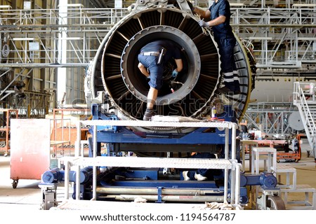 Jet engine remove from aircraft (airplane) for maintenance at aircraft hangar.Jet engine maintenance and change part by aircraft technician .