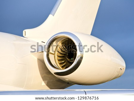 Jet Engine with a part of a wing on a Private Plane - Bombardier Global Express - stock photo