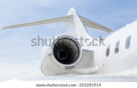 Jet Engine with a tail and part of a wing on a luxury private Jet Plane #203285914