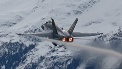 jet fighter in a mountain environment with snow