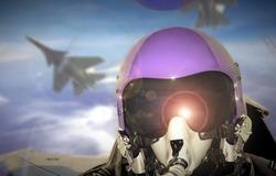 Jet fighter pilot cockpit view during sunrise