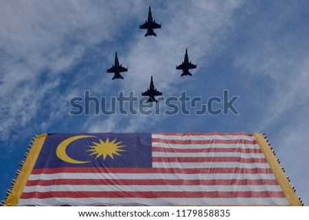 Jet fighter was cross over the Malaysia flag this photo was shoot at magic moment with wide angle lens and available light