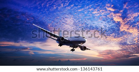 Jet in a sunset sky