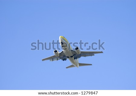 Jet landing (Boeing 737) over a blue sky background with all gear off