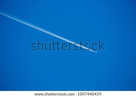 Jet plane is flying high on blue sky #1007440459