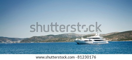 Jet ship in blue bay near Bodrum town.